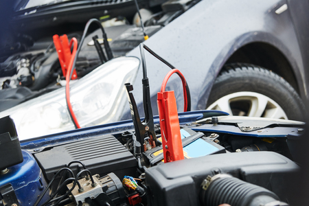 Automobile help. booster jumper cables charging automobile discharged battery Stock Photo