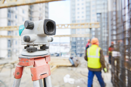 construction and building surveying. Surveyor level on building area