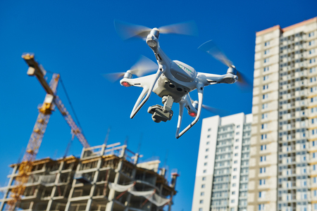 drone survellance over construction area. building site inspection. Reklamní fotografie