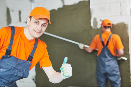 plaster service. portrait of male plasterer Stock Photo