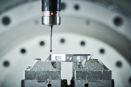 Quality control on milling CNC machine. Precision probe sensor at industrial metalworking