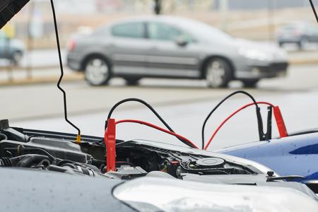 Automobile help. booster jumper cables charging automobile discharged battery Reklamní fotografie