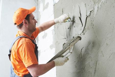 Plasterer putting plaster on wall. slow motion