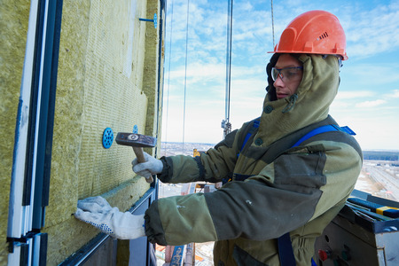 building facade exterior wall insulation work with stone mineral wool