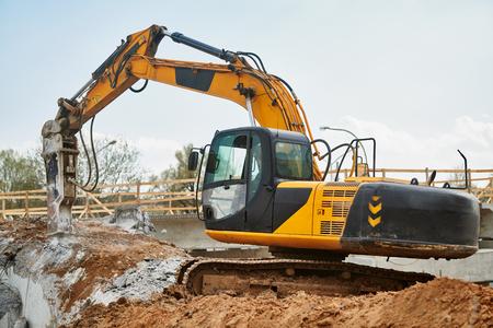 hydraulic breaker hammer excavator at demolition work