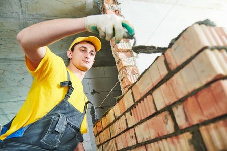 bricklaying. Construction worker building a brick wall Stock Photo