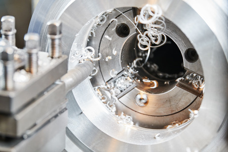 cutting tool counterboring a hole at metal working Stock Photo