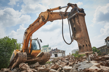 secondary demolition by excavator with hydraulic hydrohammer breaker
