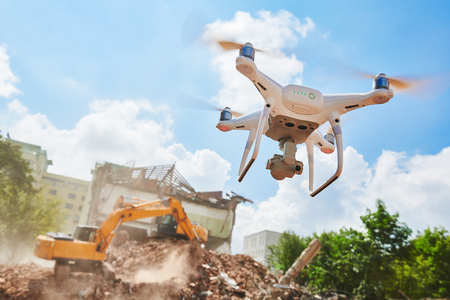 Drone inspecting construction demolition site or building area Stock Photo