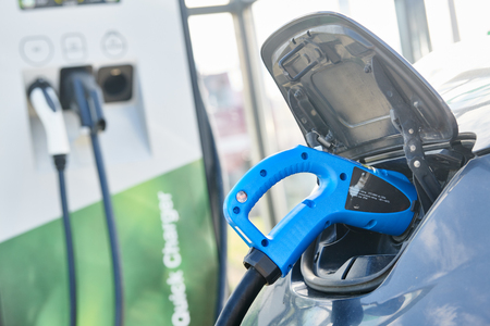 electric car charging. Ecological automobile Stock Photo