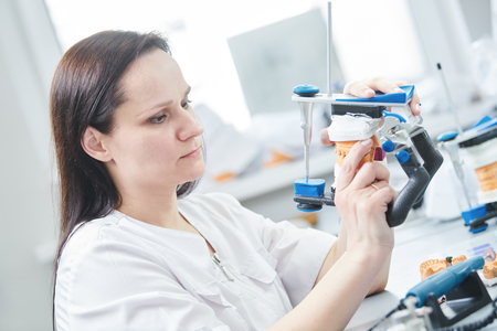 dental technician or female prosthesis worker. prosthetic dentistry process
