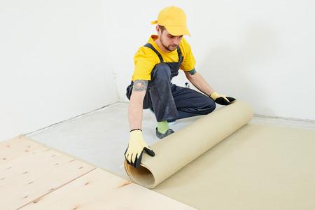 flooring work. underlayer installation at preparation for wood parquet floor