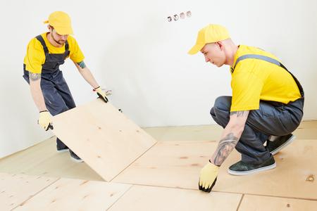 flooring work. plywood installation at preparation for wood parquet floor
