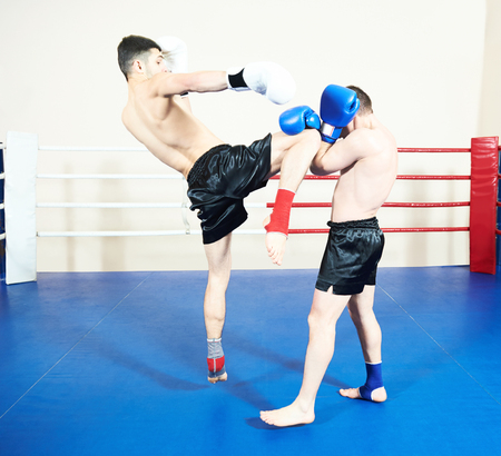 Thai boxer fighting at training ring Stock Photo