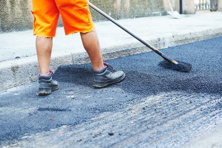 Asphalt road work . Repair urban street Reklamní fotografie