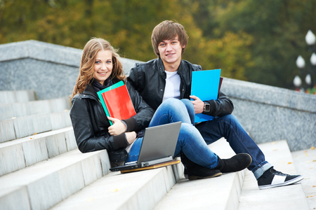 Education and students. Happy young college student with notebooks Stock Photo
