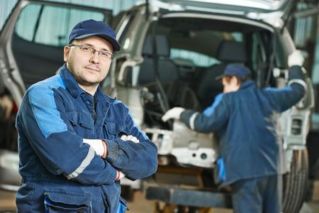 Repairman auto mechanic at car service garage
