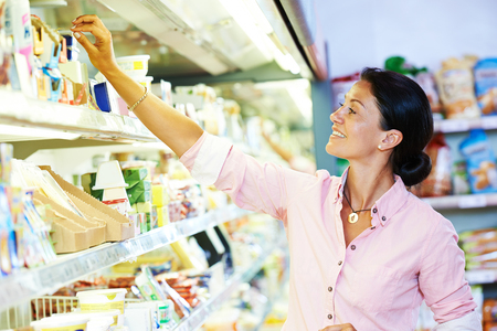 shopping in supermarket. Woman choosing foodproducts Stock Photo