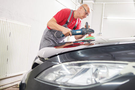 auto mechanic buffing car autobody Reklamní fotografie