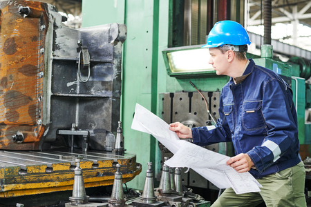 production engineer or industrial worker with drawings at factory Stock Photo