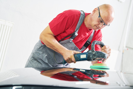 auto mechanic buffing car autobody Stock Photo