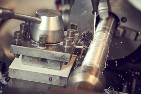Thread cutting tool at metal working lathe machine
