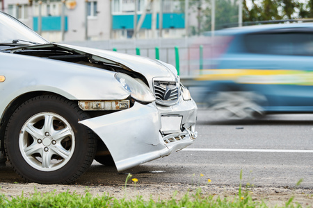 car accident on street. damaged automobile after crash in city Stock Photo
