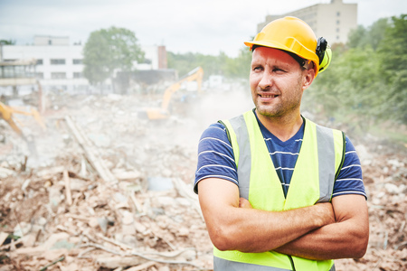 Demolition construction work. Worker at building site Stock Photo