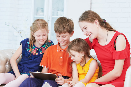 children playing on tablet computer