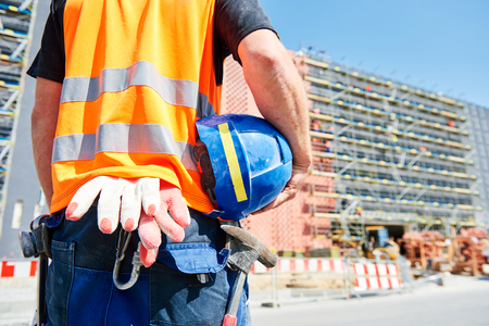 builder worker on construction site Stock Photo