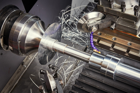 Sheet metal forming processes. spinning blank on cnc lathe machine Stock Photo