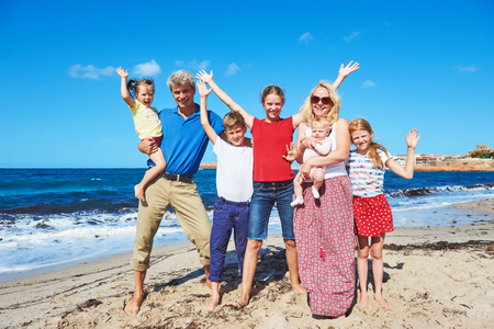 big family with children at summer vacations. sea beach