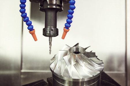 Milling metalworking process. CNC machining of turbine impeller by vertical mill Stock Photo