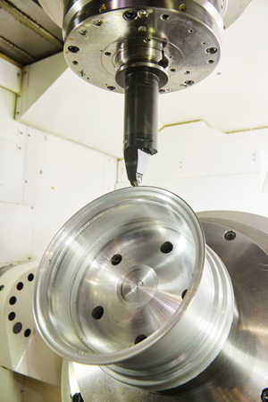 Milling metalworking process. CNC metal machining by mill. Stock Photo
