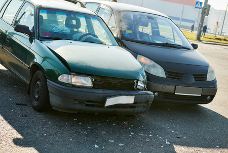 car crash accident on street. damaged automobiles with triggered air bag