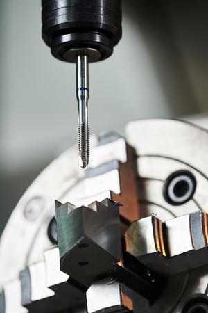 internal thread cutting process on cnc machine by tap Stock Photo