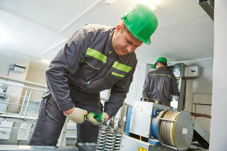 elevator machinist make maintenance in engine room Stock Photo