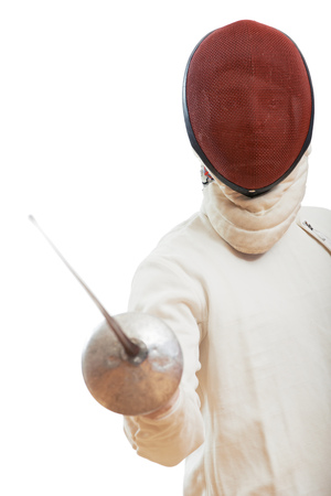 Fencing. fencer in costume and mask holding the sword. Ready to attack