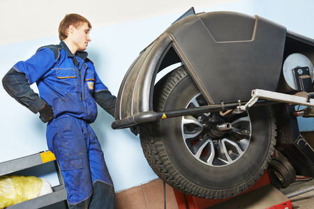 tyre fitting. SUV car wheel balancing in tire service.