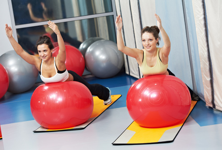 Fitness class. women doing exercise with fitness ball