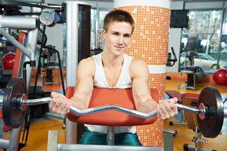 Fitness and sport. man doing abdominal muscles exercises in gym