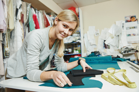tailoring and sewing. Female tailor at work