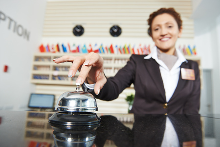 Hotel female worker on reception Stock Photo