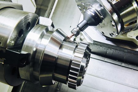 Milling metalworking process. Industrial CNC metal machining by vertical mill.