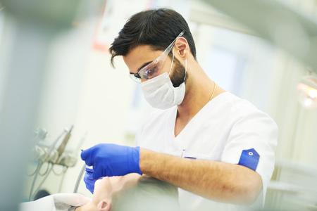 male dentist at work