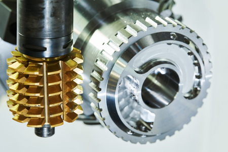 cogwheel milling process. Industrial CNC metal machining by hobbing cutter mill