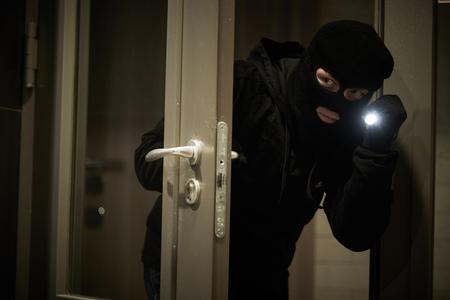 Burglar thief in mask. break-in of an apartment. Stok Fotoğraf