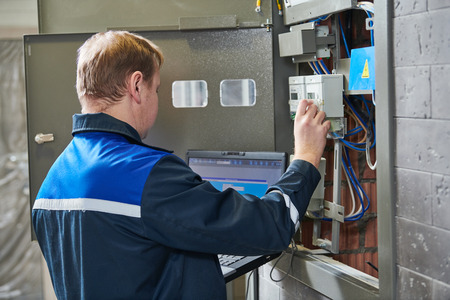 Electricity power control and metering. Worker checks data