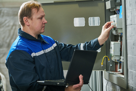 Electricity power control and metering. Worker collects data