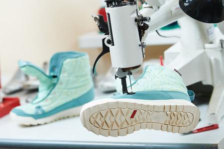 Shoemaker repair shoe. sewing the sole of footwear